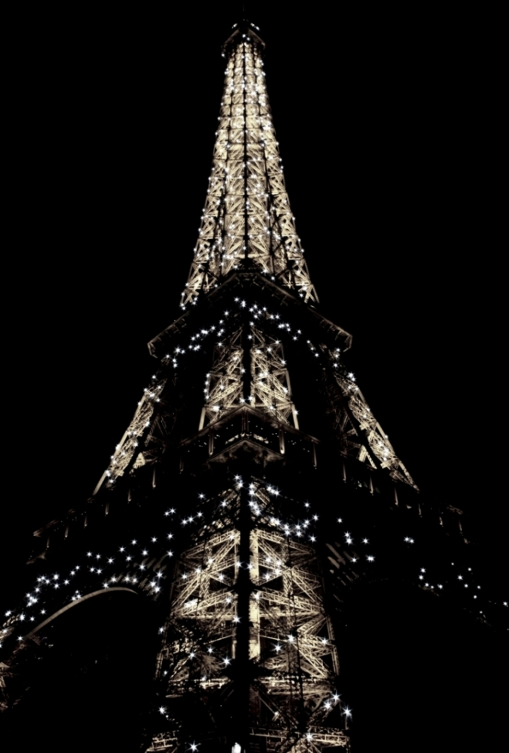 Eiffel Tower, Lit Up at Night. Paris, France.